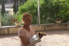 Bev Reading in the Garden of Gethsemane